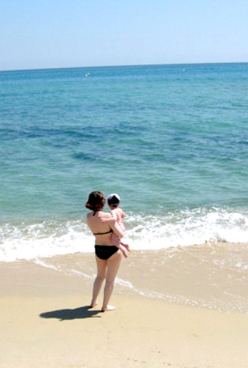 Stephanie Bonnet, boutique hotel blogger, on the beach with Mademoiselle in Pampelonne, near Saint Tropez