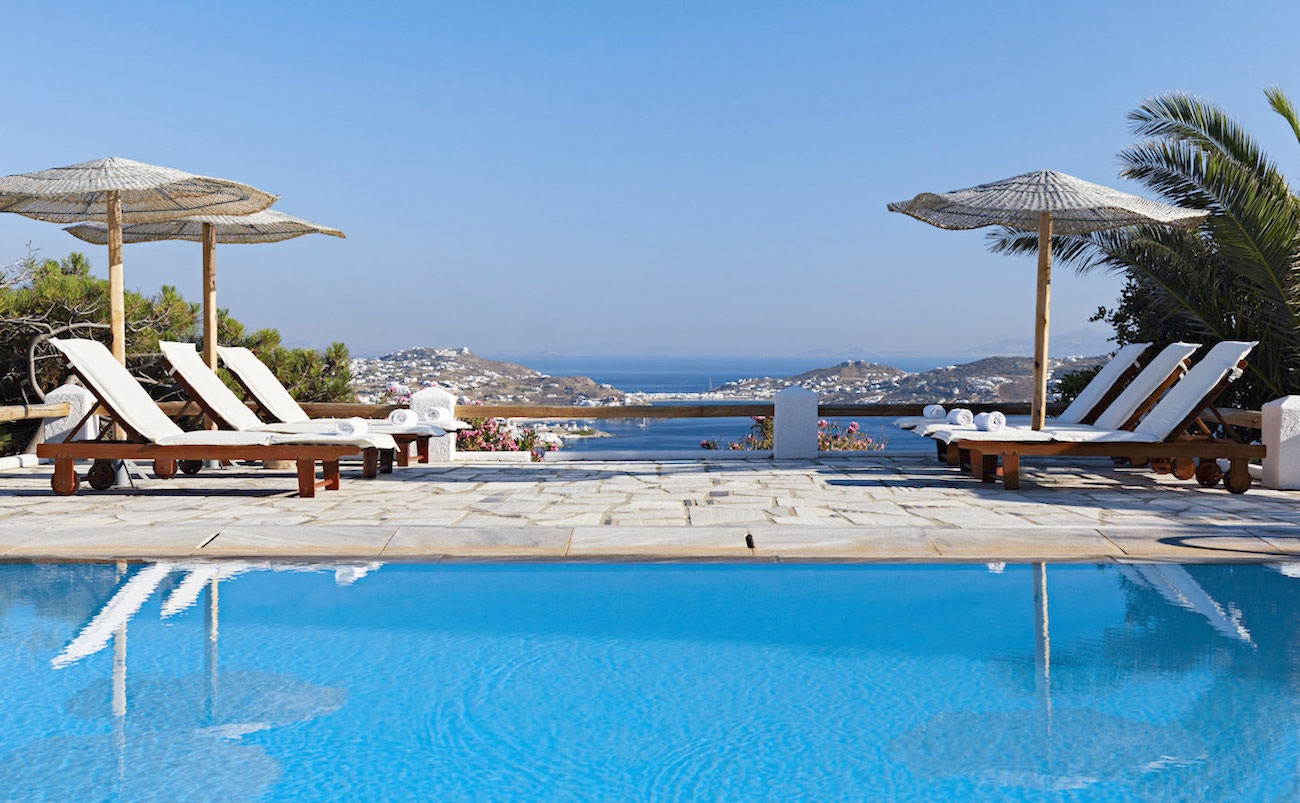 The pool at Agnandi Mykonos. One of the 5 stylish holiday rentals in Greece that you can discover in this post. #greece #holidayrental #villarental #beachholiday